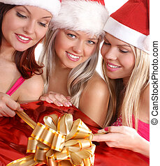 Christmas group portrait Three young attracive girls with...