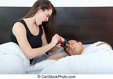 Unhappy woman and her snoring husband - Young girl being...
