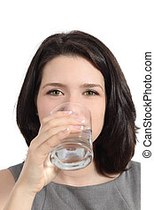 Pretty woman drinking water from a glass isolated on a white...