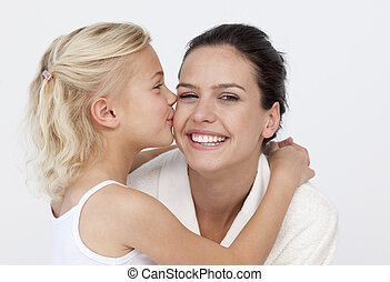 Daughter kissing her mother in the bathroom