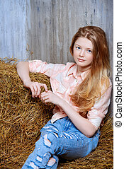 luxury - Pretty girl teenager in shirt and torn jeans posing...