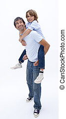 Dad giving son piggyback ride - Dad giving son piggy back...