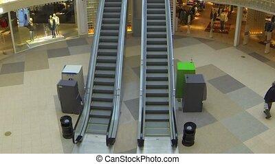 escalator time lapse camera in moti - shopping mall tilt...