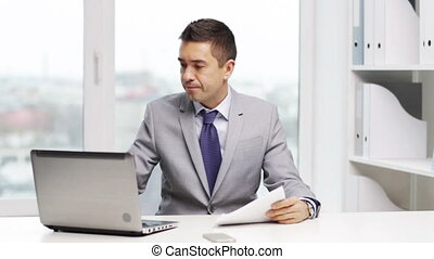 businessman with laptop and papers - business, people,...