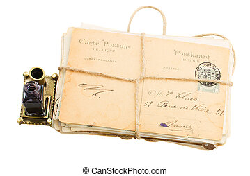 pile of old mail and aged photos - pile of old mail with...