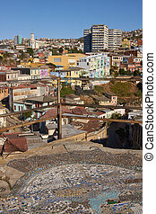 Valparaiso - Colourfully decorated houses crowd the...