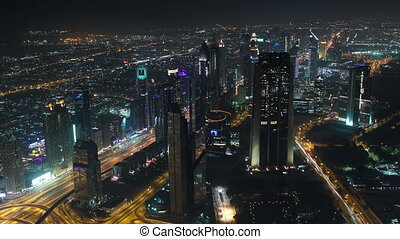 Dubai downtown at night with city lights from Burj Khalifa timelapse