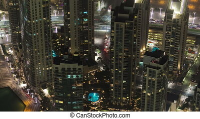 Dubai downtown at night with city lights from Burj Khalifa...