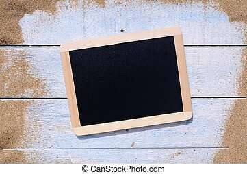 Blackboard on beach - Blackboard and blue wooden table on...
