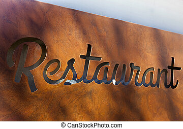 Restaurant - Rusty sign in the facade of a restaurant