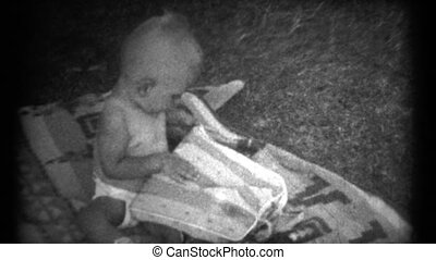 1940s 8mm Vintage Baby Playing - A baby playing around...
