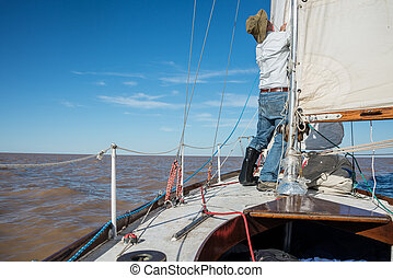 Senior retired sailing Buenos Aires River to Uruguay Sport...