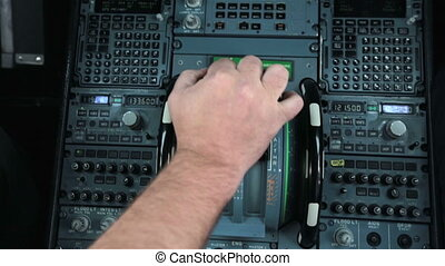 Glass cockpit cabin door inside. Hand of pilot push thrust...