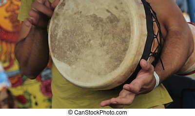 Playing  the drum on ethnic festival