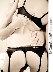 sexual foreplay - a couple in sexual foreplay in underwear