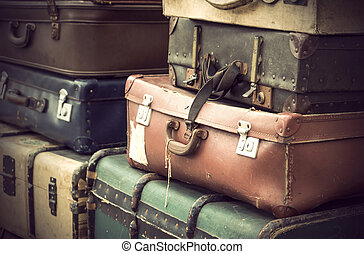 vintage leather suitcases - Heap of worn vintage leather...
