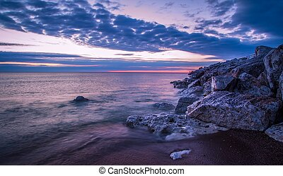 Lake Huron Sunrise - Wave crashes over the rocky Lake Huron...