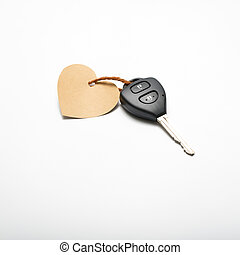 car key and heart tag isolated on white background