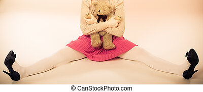 childlike woman with teddy bear toy - Mental disorder...