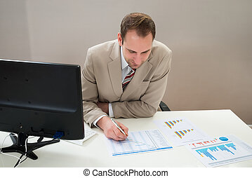 Businessman Making Gantt Diagram - Businessman At Desk...