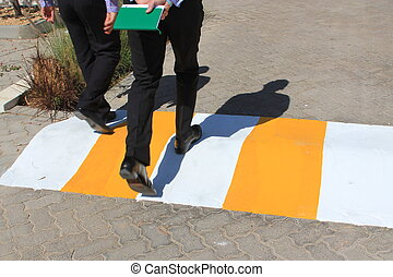 Speed bump on the road - Yellow and white speed bump on the...