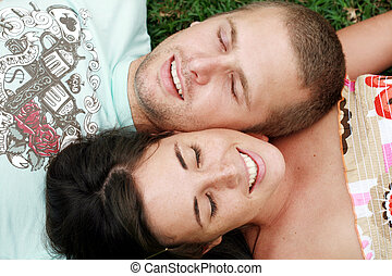 couple dating - a couple dating and lying together smiling