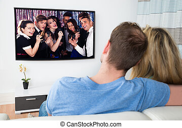 Couple Watching Television At Home - Couple Watching Movie...