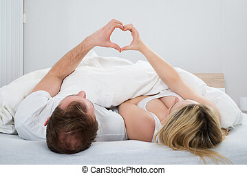 Couple Forming Heart Shape