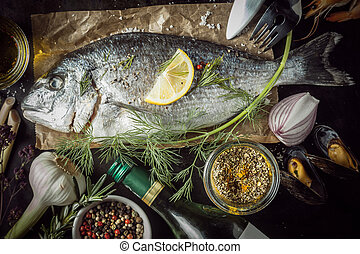Raw Fish Surrounded by Seasonings and Ingredients - Raw Fish...