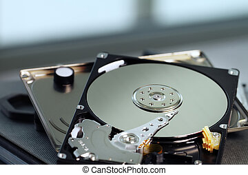 Close up of open computer hard disk drive on notebook -...