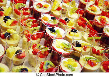mousse au chocolat and red fruit jelly dessert decorated...