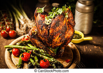 Gourmet Grilled Whole Beer Can Chicken on Wooden Board -...