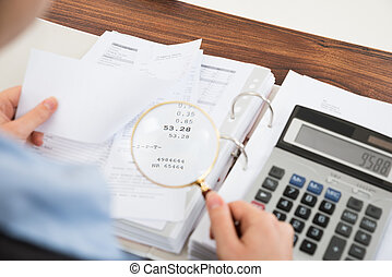 Businessperson Examining Receipts - Close-up Of...