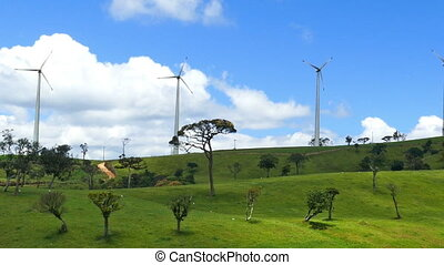 Wind turbines on green hills - wind farm