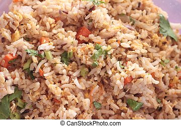 Fried rice put crab on dish