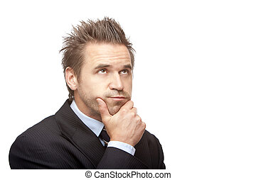 Businessman looks contemplative because of a problem -...