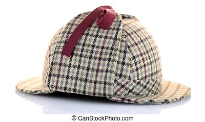 British Deerhunter or Sherlock Holmes cap on white...