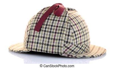 British Deerhunter or Sherlock Holmes cap on white...