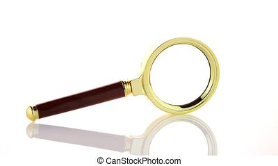 Old magnifying glass isolated over white background.