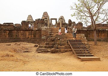East Mebon temple ruins - Tourists are visiting the East...