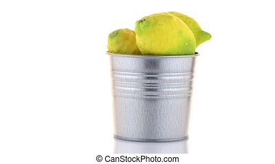 Bucket with lemons on white background