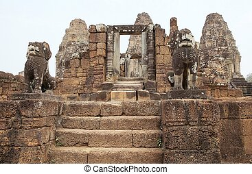 East Mebon temple ruins - The lion guardians at the East...