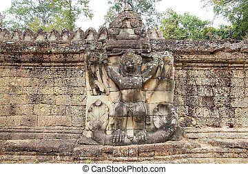 Preah Khan - Garuda holding naga sculpture on the external...