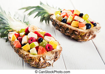 Fresh Fruit Salads in Pineapples on White Table - Close up...