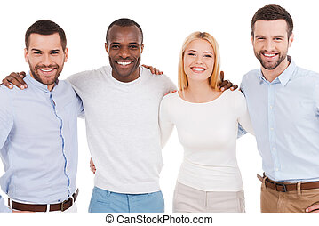 Happy business team. Four happy young people in smart casual wear looking at camera while bonding to each other and standing against white background