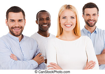 Happy to be a team. Four happy young people in smart casual wear looking at camera while bonding to each other and standing against white background