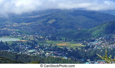 Nuwara Eliya, Gregory lake and clouds over - Aerial pan view...