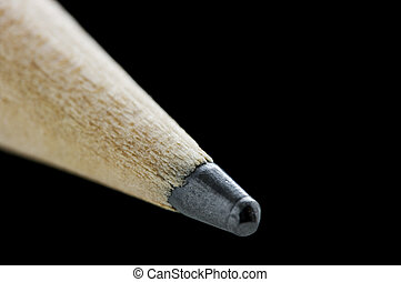 Tip of pencil over black with shallow DOF, focus where the...