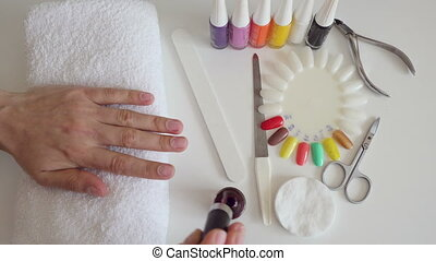Manicure process in beauty salon, close up