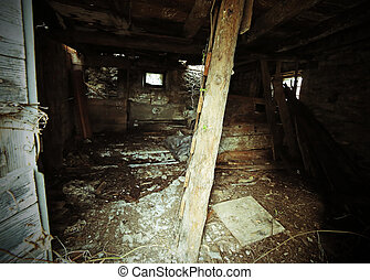 house in ruins with danger of collapse and an old wooden...